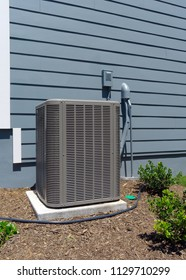 Air Conditioner unit attached to residential house