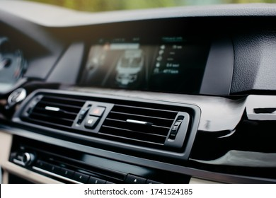 Air conditioner vent grill in a modern car.