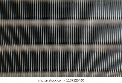 An air conditioner's evaporator coil, also called the evaporator core, is the part of the system where the refrigerant absorbs heat. That is, it's where the cold air comes from.