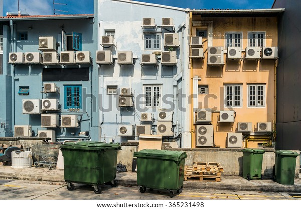Air conditioners on the wall on the back street. Urban design solutions.