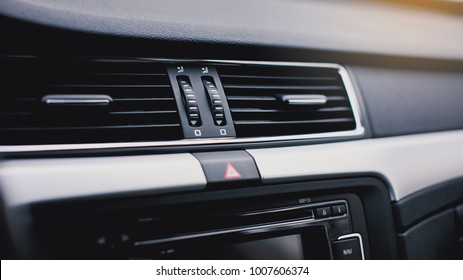 Air conditioning button inside a car. Climate control AC unit in the new car. Modern car interior details.