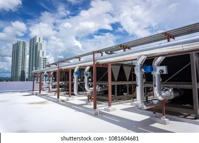 The air conditioning chiller consists of a metal hose. All are mounted on the roof of the building.