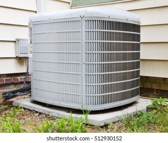 Air conditioning compressor in backyard