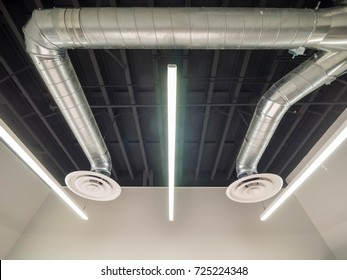 Air conditioning ducting with round diffuser and LED lighting