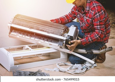 Air conditioning service, repair & maintenance concept. The technician repairing the air conditioner.