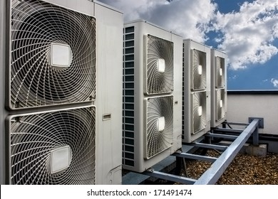 Air conditioning system assembled on side of a building.