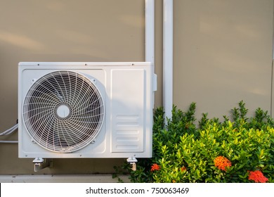 Air conditioning system installation embedded on wall of building