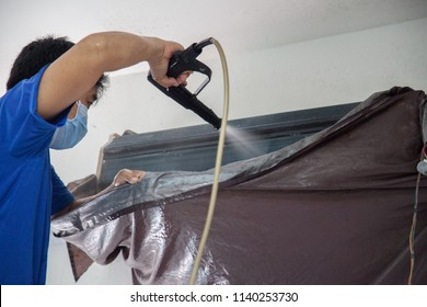 Air conditioning technician is cleaning air conditioner.