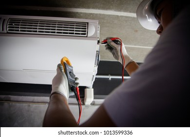 Air Conditioning Technician and A part of preparing to install new air conditioner.