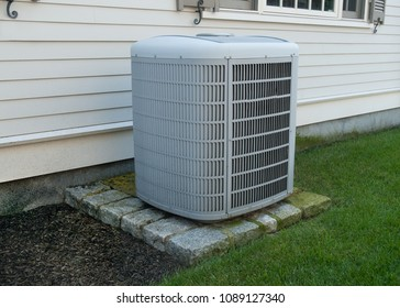 Air conditioning unit outside a house