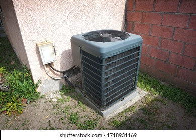 Air conditioning unit outside of house