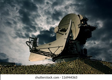Air defence radar over dramatic night sky.