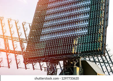 Air defense radars of military mobile antiaircraft systems, modern army industry on background beautiful clouds and blue sky