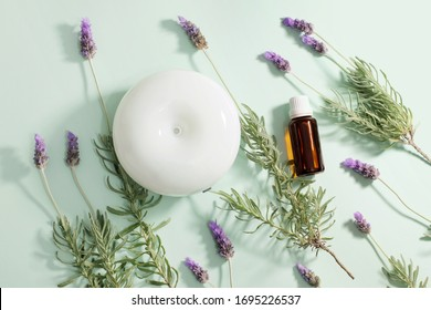 Air Diffuser and Lavender Oil on Green Background