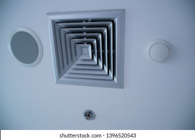 Air Duct Ceiling white, Air duct in square shape, condition vent modern air conditioner or air vent on ceiling white, Duct for conditioning heating on a building ceiling