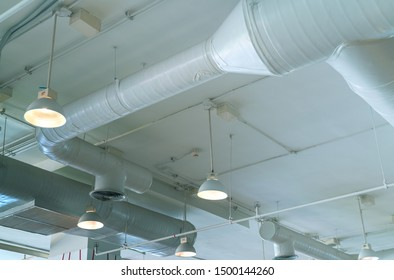 Air duct, air conditioner pipe, wiring pipe, and fire sprinkler system. Air   flow and ventilation system. Building interior. Ceiling lamp light with opened light. Interior architecture concept.