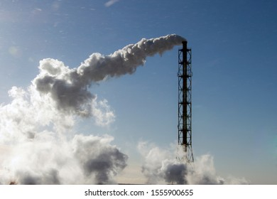 air emissions from an industrial pipe on a blue sky background