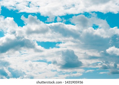Air and fluffy clouds in the blue sky on a sunny day, background texture
