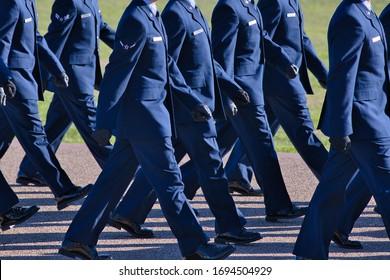 Air Force basic training graduation parade, new airmen marching.