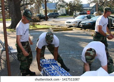 Air Force personnel begin to deliver bottled water to Hurricane Katrina victims. Taken in Biloxi, MS on September 5, 2005.
