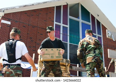 Air Force personnel pack bottled water for Hurricane Katrina victims. Taken at Biloxi, MS on September 8, 2005.