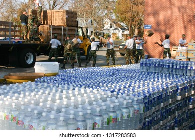 Air Force personnel prepare to deliver bottled water to Hurricane Katrina victims. Taken in Biloxi, MS on September 8, 2005.