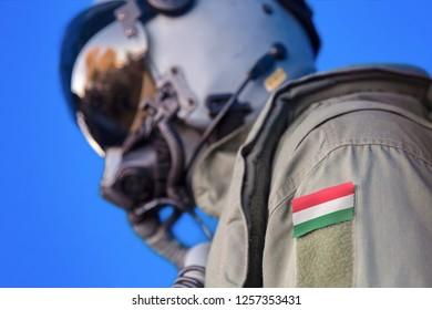 Air force pilot flight suit uniform with Hungary flag patch. Military jet aircraft pilot