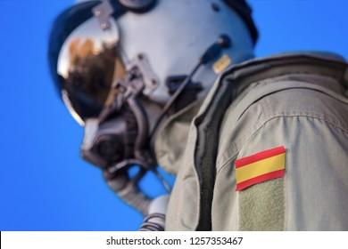Air force pilot flight suit uniform with Spain flag patch. Military jet aircraft pilot