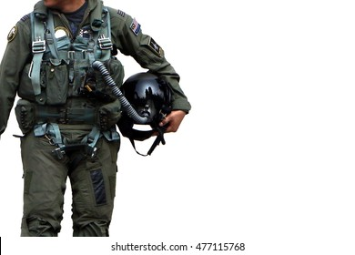 Air force pilot walking over white