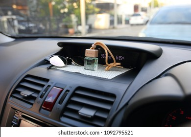 Air freshener on car's dashboard in clean air and refreshment on travel concept