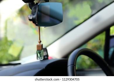 Air freshener on dashboard of car.