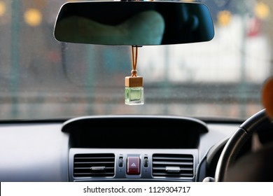 Air freshener on dashboard of car.