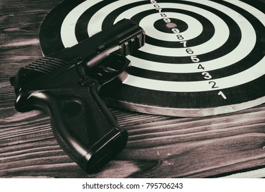 Air gun  and a target on the table