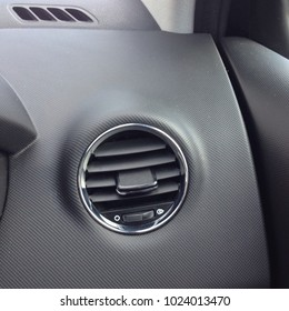 Air heater vent in car dashboard interior closeup