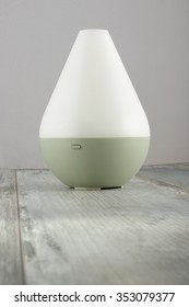 Air humidifier on the aged wooden background