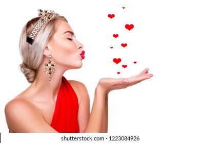 air kiss. sexy girl makes a kiss over his hand. Red lips. happy luxury model in beautiful clothes on a white background. closed eyes for joy - Image