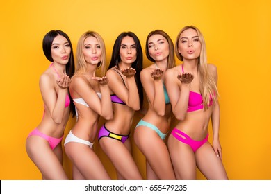 Air kiss for you from five hot ladies in fancy colorful swim wear, standing in tempting poses. So hot, sensual, perfect, ideal bodies and figures! Summer, diet, joy and health concept