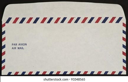air mail envelope isolated on black background par avion
