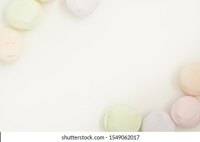 Air marshmallows in pastel shades. A gentle marshmallows.  Marshmallows that you want to eat. A gentle zephyr on a white background. Marshmallows in a light key. Frame made of marshmallow.