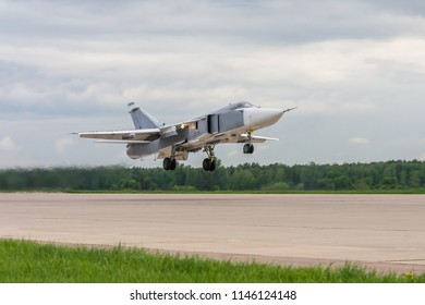 Air military bomber perfoming take off from the airbase runway in Russia. Air fighter flying around base. Aviation mission of military flight.