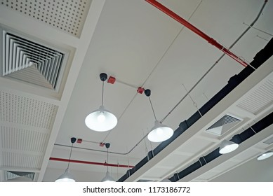 Air outlet and acoustic ceiling in the modern office.