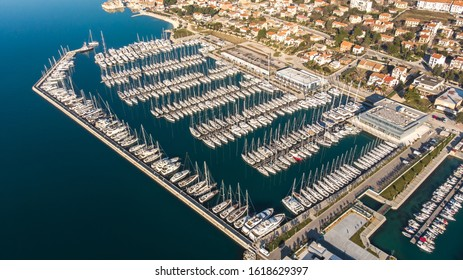 Air photo, marina between Trogir and Split, Croatia. Photo taken in the early morning.