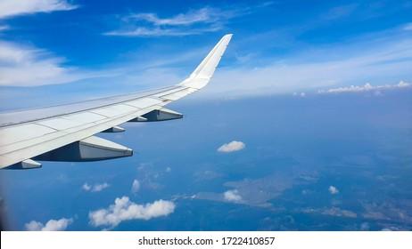 Air plane flying in a beatiful blue sky.