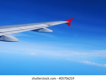 Air plane wing in the sky