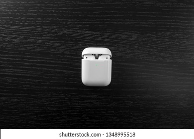 Air Pods. with Wireless Charging Case. New Airpods 2019 on black background. Airpods