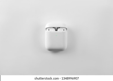 Air Pods. with Wireless Charging Case. New Airpods 2019 on white background.  Airpods.