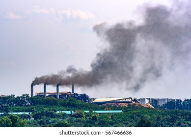 Air pollution by smoke coming out of two factory