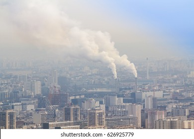 Air pollution by smoke coming out of two factory chimneys, Paris, France