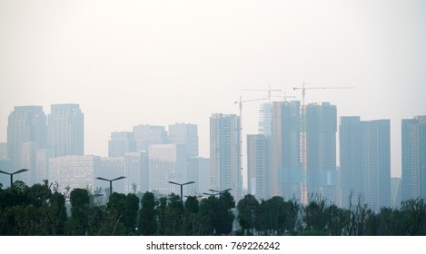 Air pollution in the city with skyscraper buildings in the haze