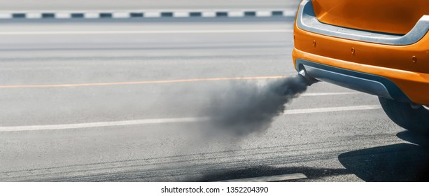air pollution crisis in city from diesel vehicle exhaust pipe on road